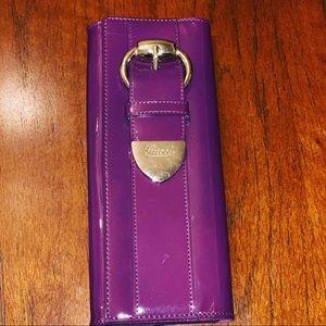Purple Gucci clutch.